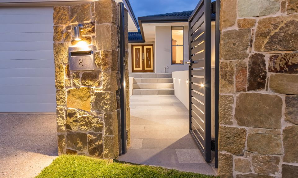 Clancy wall cladding and magma rock feature tiles at entry