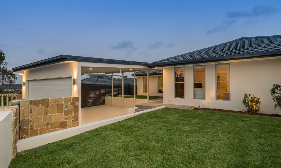 Rendered house, Clancy wall cladding, double carport