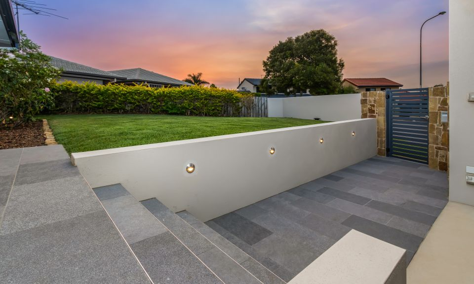Tiled entry pathway and entry steps with feature lighting
