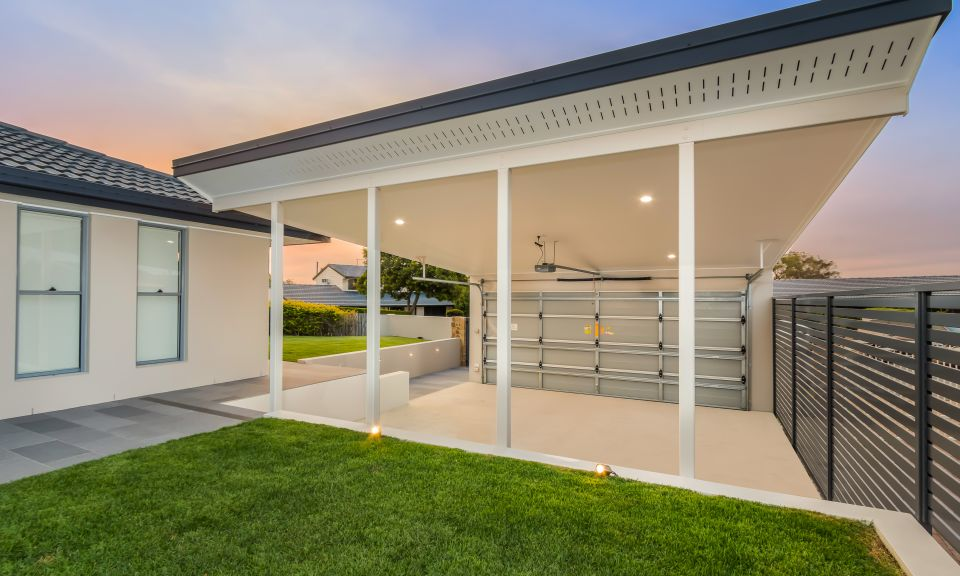 Double carport and front entry with featured tiled pathway and external lights